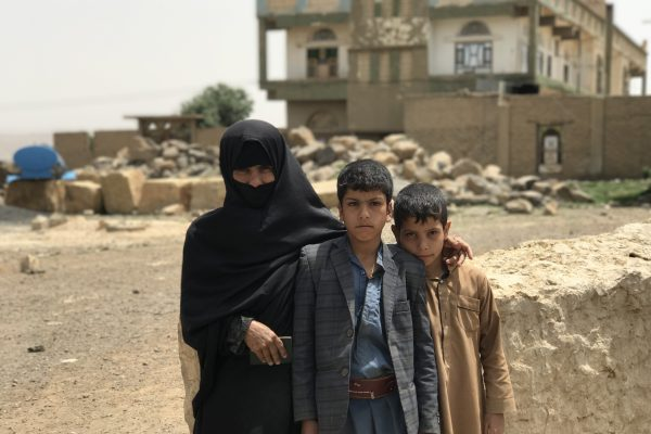 Shafeeqa Eid with her two children in Amran Governorate. She lost her husband this Ramadan to sickness and is now the sole breadwinner for her family, working as a day laborer at nearby farms. She received UNHCR rental assistance to help her and her family cope in exile as they struggle to pay the rent and keep a roof over their heads. ; UNHCR is responding to the humanitarian crisis in Yemen, providing emergency assistance to those forcibly displaced by the conflict. Recent fighting in Yemen has made years of poverty and insecurity even worse. The conflict has disrupted millions of lives, with 2 million internally displaced and a further 1 million having returned home to dangerous conditions. More than 20 million Yemenis need humanitarian assistance. UNHCR provides emergency shelter and household assistance including mattresses, blankets, sleeping mats, kitchen sets, buckets and other essential items. Our assistance has reached people in all 20 governorates affected by the conflict. We also refurbish public buildings that now host displaced families. We provide legal and financial assistance as well as psycho-social support, and we continue to protect and support some 280,000 refugees, mainly from the Horn of Africa, who remain in Yemen despite the conflict.