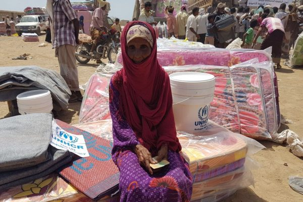 Thousands of displaced Yemenis from villages in the district of Mokha receive mattresses, sleeping mats, blankets, kitchen sets and wash buckets at a UNHCR distribution point. ; After weeks of negotiations, UNHCR reached the district of Mokha in Yemen's western governorate of Taizz on 20 March 2017. Hostilities between the warring parties have escalated here since the beginning of the year and the intensified fighting has led to tens of thousands being forcibly displaced. UNHCR teams distributed emergency aid to over 3,400 people in the first few days after gaining access. Many are traumatised and living in desperate conditions, lacking water and sanitation. At the time these pictures were taken, two million people were displaced across Yemen and one million had returned home to precarious conditions. Despite the desperate human suffering, by late-March 2017 UNHCR had received less than $10 million of the $99 million it needs to respond to the looming humanitarian catastrophe. We are appealing for urgent international support.